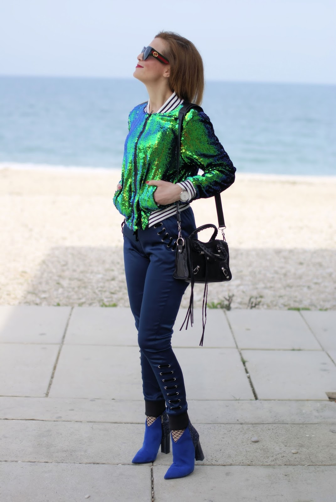 Sequins bomber jacket, lace up pants and Gucci sunglasses on Fashion and Cookies fashion blog, fashion blogger style