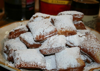 Beignets are slightly sweet fritters, deep fried and sprinkled with a generous dousing of powdered sugar. Best when served with a strong New Orleans chicory coffee.
