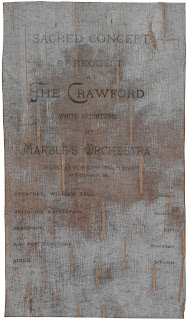 Concert playbill printed on dark birch bark