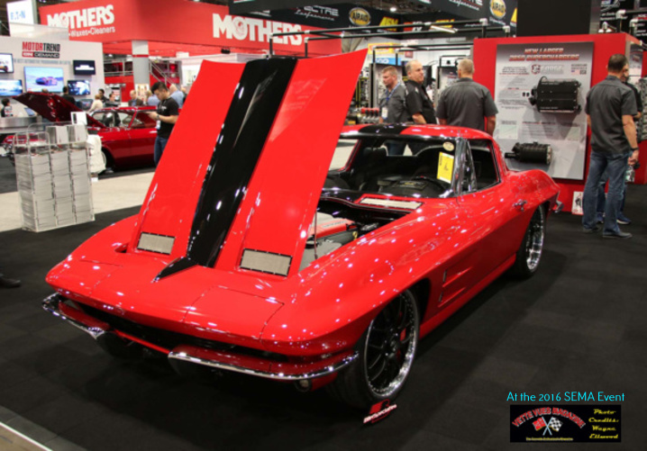 The exterior  red paint on this 1963 Corvette was enhanced with decorative steel mesh where C2s normally displayed more traditional chrome pieces or where vents were just an indication.