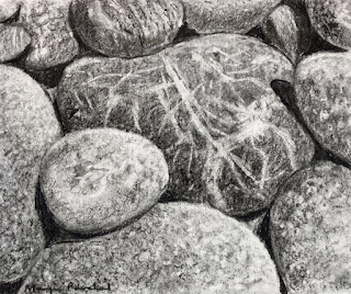 A charcoal drawing of pebbles on cartridge sheet by Indian artist Manju Panchal