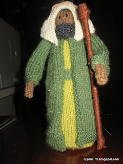 a shepherd, complete with crook, knitted from Jean Greenhowe's nativity instructions