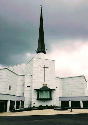 whitle church with dominent spire, and an elevated viewing box where the Pope addressed the crowd in 1979