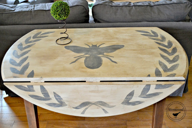 The Drop Leaf Table with a Wreath and a Bee