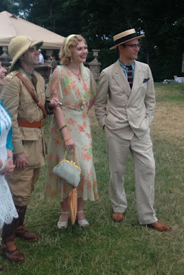 Young man in 1920s safari costume with other 1920 outfits at the Roaring Twenties Lawn Party in Boston's North Shore