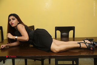 Tollywood Upcoming Actress Pooja Roshan Stills in Black Short Dress at Plus 1 Movie Trailer Launch  0364.JPG