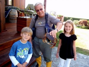 Grandpa Anders with a Dungeness Crab and the grand kids Ryan and Sarah.