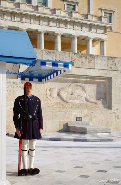 Presidential Guard (Evzones) with the traditional winter uniform at the Tomb of the Unknown Soldier in front of the Hellenic Parliament. Constitution Square Platia Sintagmatos of Athens.