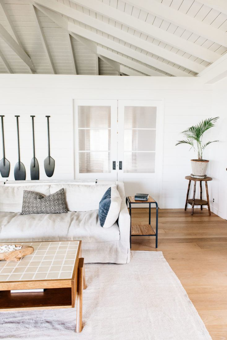 Gorgeous white modern living room in beautiful oceanfront cottage on Maui - found on Hello Lovely Studio