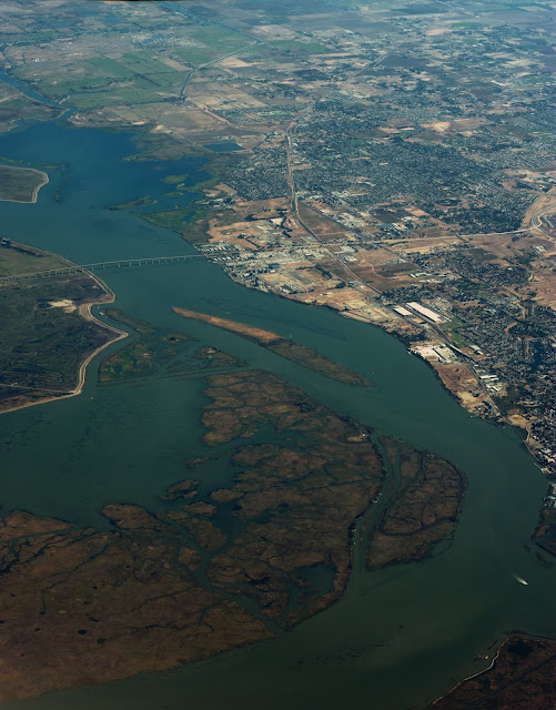 An aerial photo of a bridge spanning a channel and island in the US.