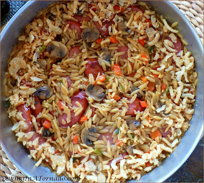 One Pan Kielbasa Orzo Dinner is an easy and flavorful meal you can make in just 1/2 hour. There's also an option for making ahead and baking later. | Recipe developed by www.BakingInATornado.com | #dinner #pasta