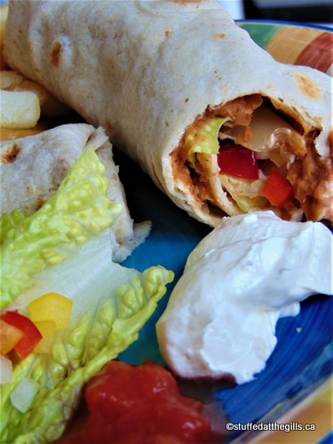 Baked Bean & Cheese Burritos showing bite out of burrito.