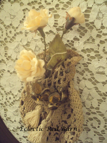 Vintage crocheted purse with clip-on earrings and silk flowers