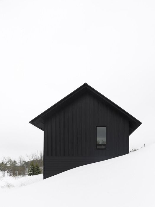black house in the snow