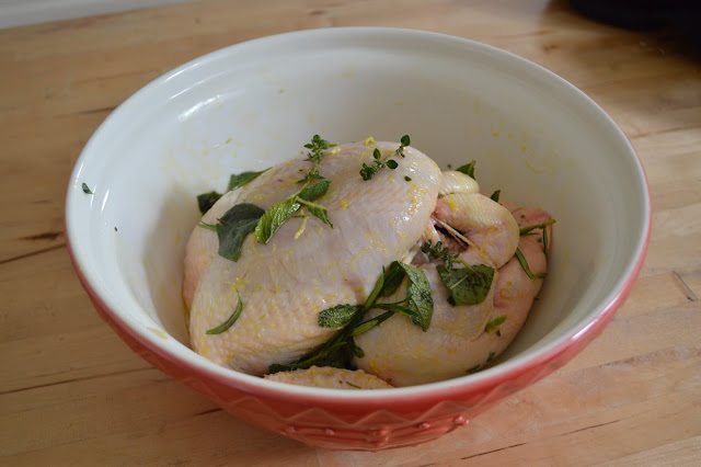 Chicken marinading in oil and herbs
