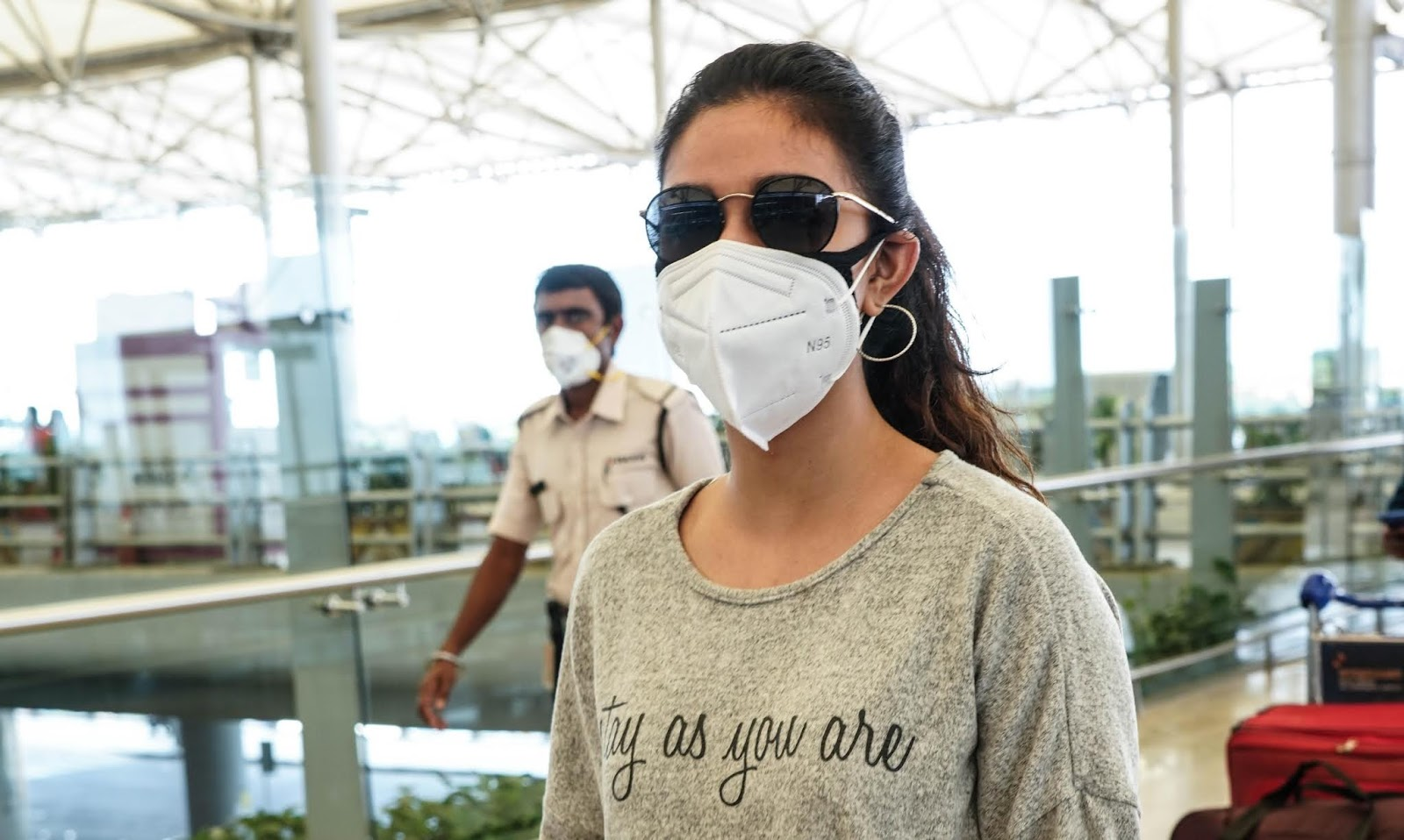 Keerthy Suresh in Yash Color T-Shirt with Mask at the Hyderabad Airport 1