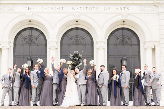 bridal party at Detroit Institute of Arts cheering