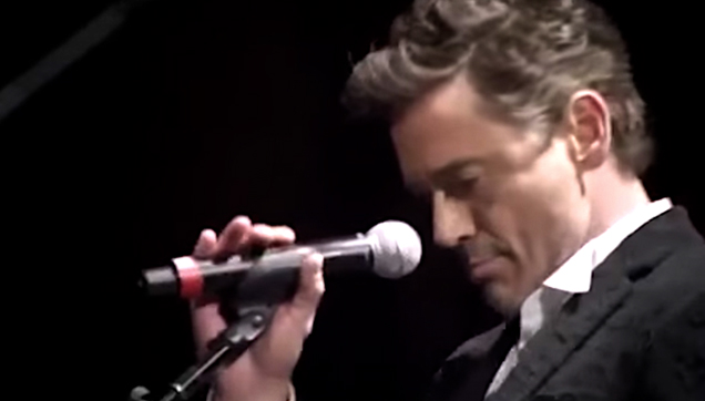 Robert Downey Jr, sings Driven to Tears with Sting