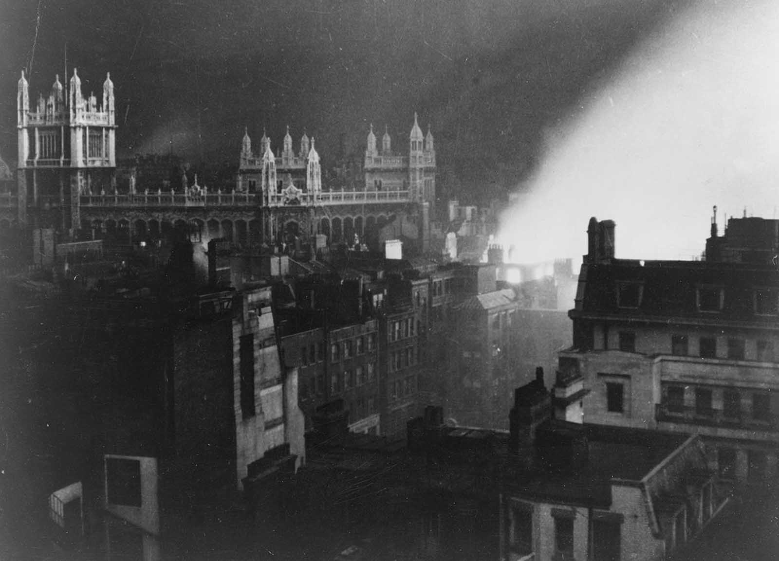 The Record Office in London, lit by flames ignited by a German air in 1940.