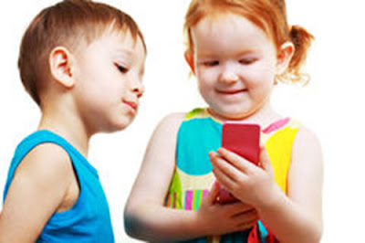 Young children toddlers playing a game on mobile phone