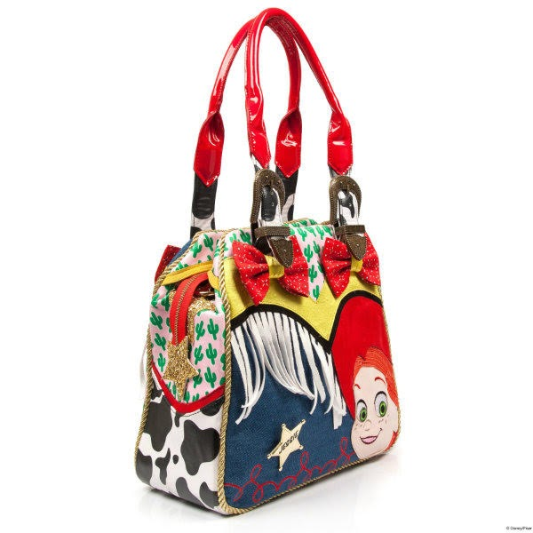 cow print, denim, cactus fabric bag with two long handles, cowgirl applique face in corner and zip top