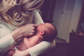 crianza en brazosFulares y tejidos KANGUTINGO