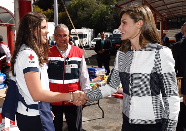 Queen Letizia wore Hugo Boss Karolie Blazer and Carolina Herrera trousers, carried Hugo Boss clutch bag