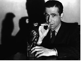 Humphrey Bogart as Sam Spade in The Maltese Falcon, the famous maltese falcon shadow scene, directed by John Huston