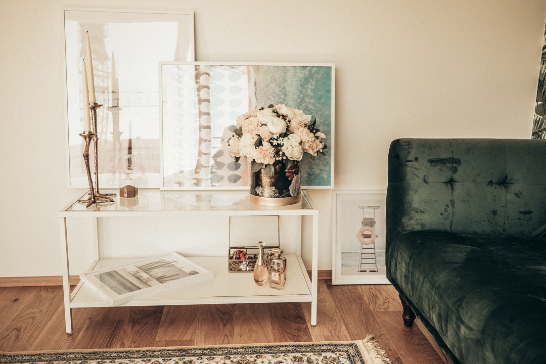 interior design home decor green velvet couch art posters side table