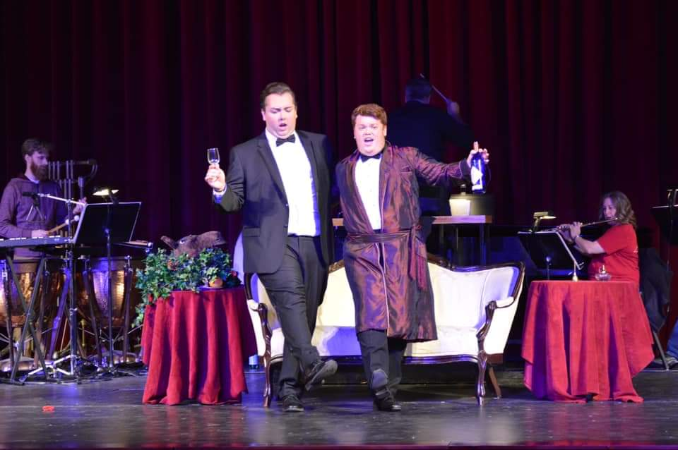 IN REVIEW: baritone GUY CHAMBERS as Frank (left) and tenor SEAN TOSO as Alfred (right) in UNCG Opera Theatre's October 2019 production of Johann Strauss II's DIE FLEDERMAUS [Photograph © by Amber-Rose Romero, Tamara Beliy, & UNCG Opera Theatre]
