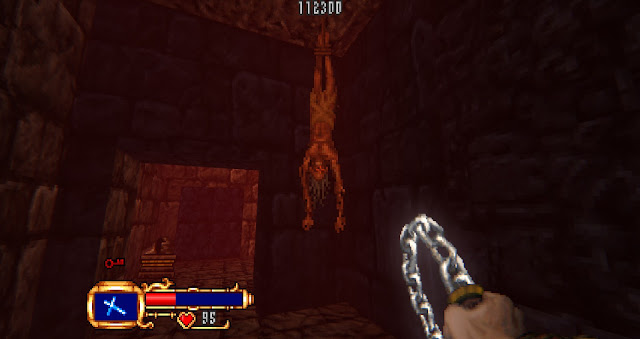 a funny-looking guy is hanged by the feet from the ceiling