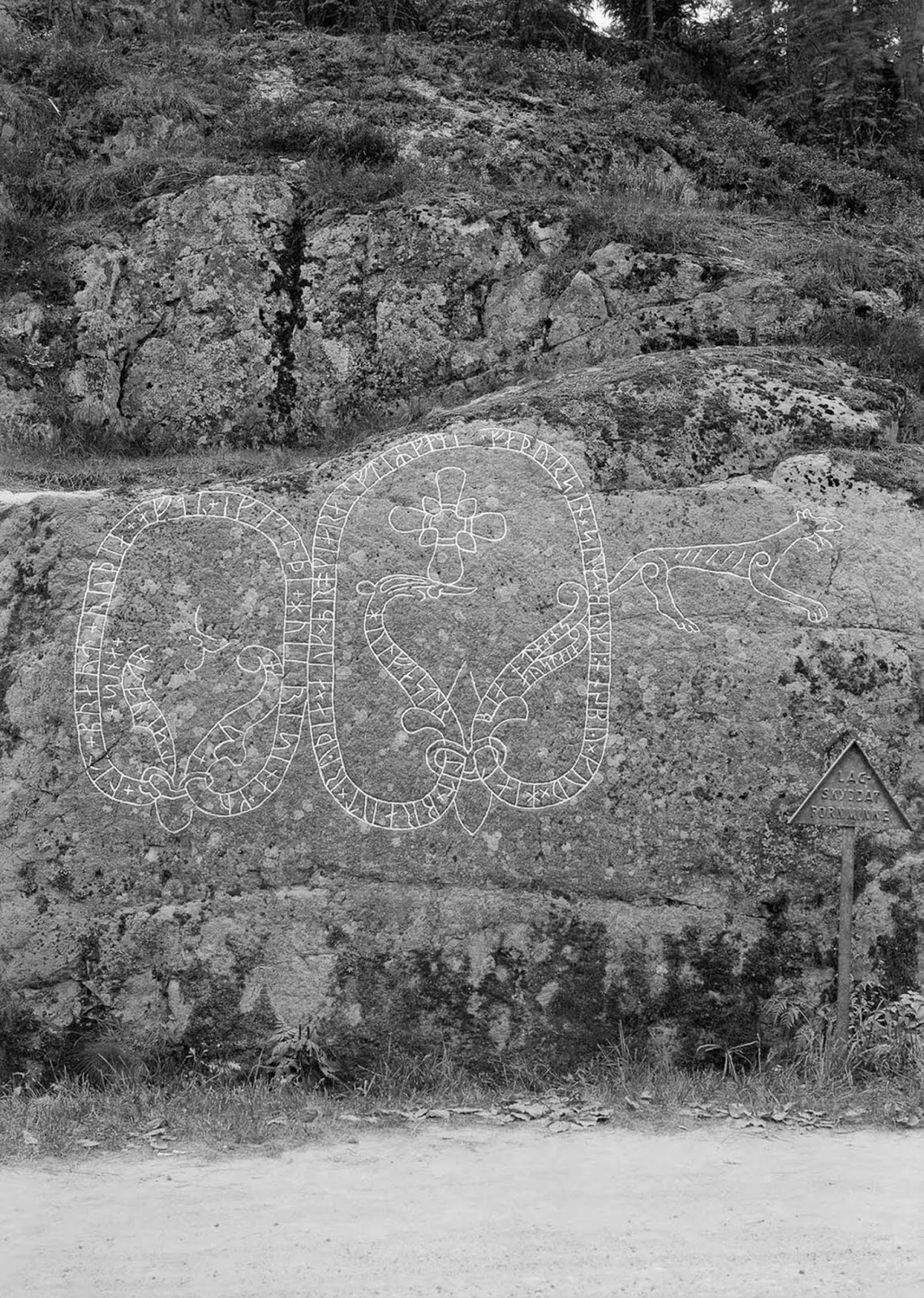 The Holmfast carving along a road in Södertälje. The inscriptions read,