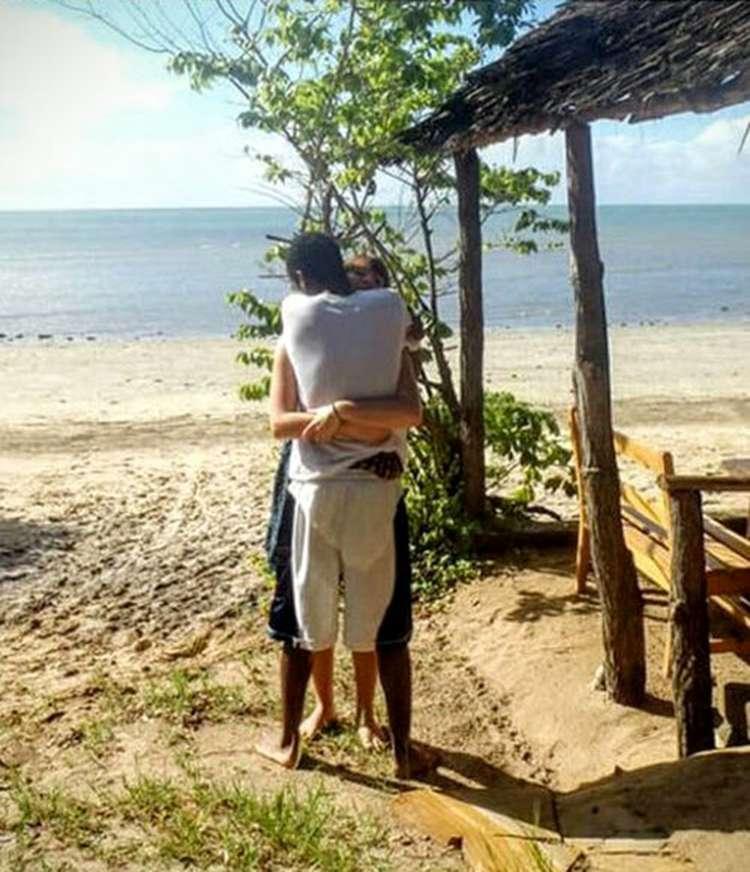 Photo of Couple Hugging Optical Illusion