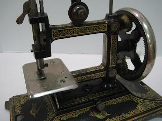 Antique miniature sewing machine