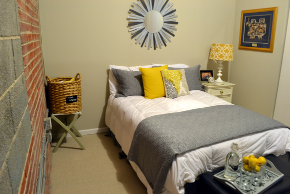 Gray and Yellow bedroom with sunburst mirror