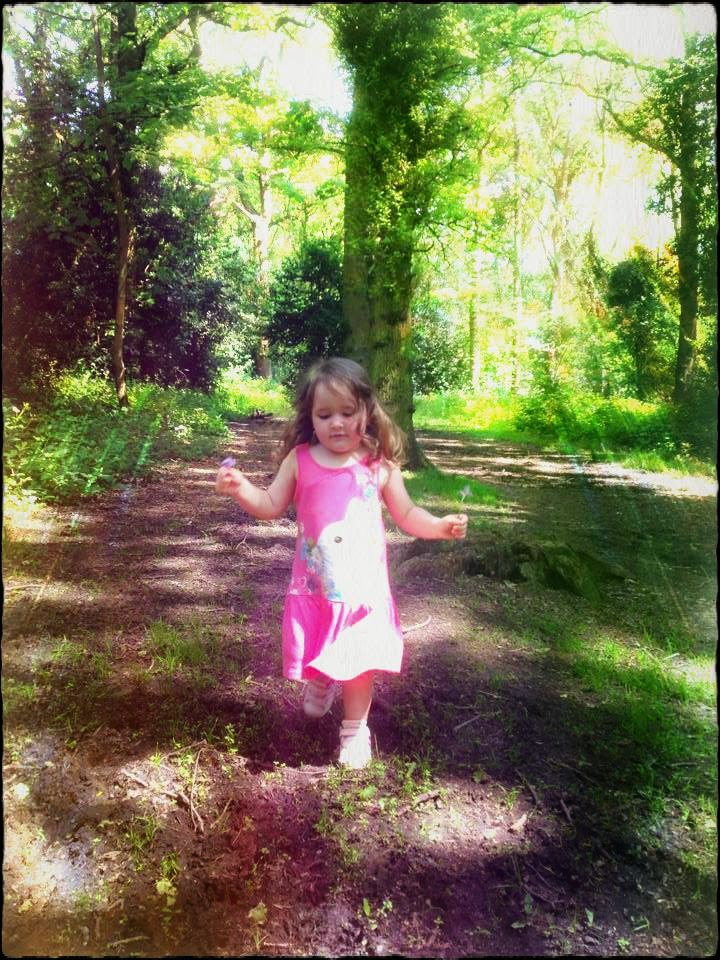 Little Girl Skipping through a forest