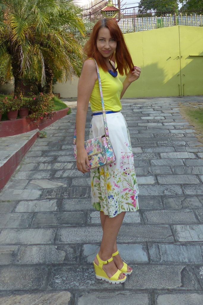 Oasis floral skirt with yellow top blue accessories and floral print bag
