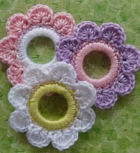 http://www.ravelry.com/patterns/library/flower-ring-decoration
