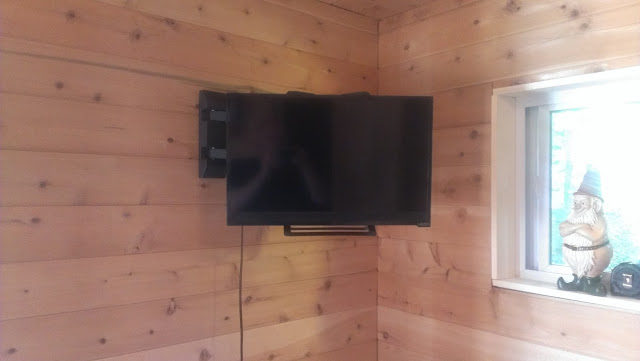 A TV is a great addition to an outdoor sauna.