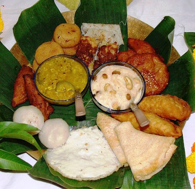 An assortment of various pithas made during the Raja festival