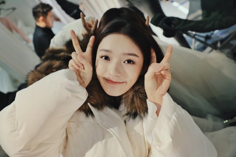 Lin Yun poses for photos
