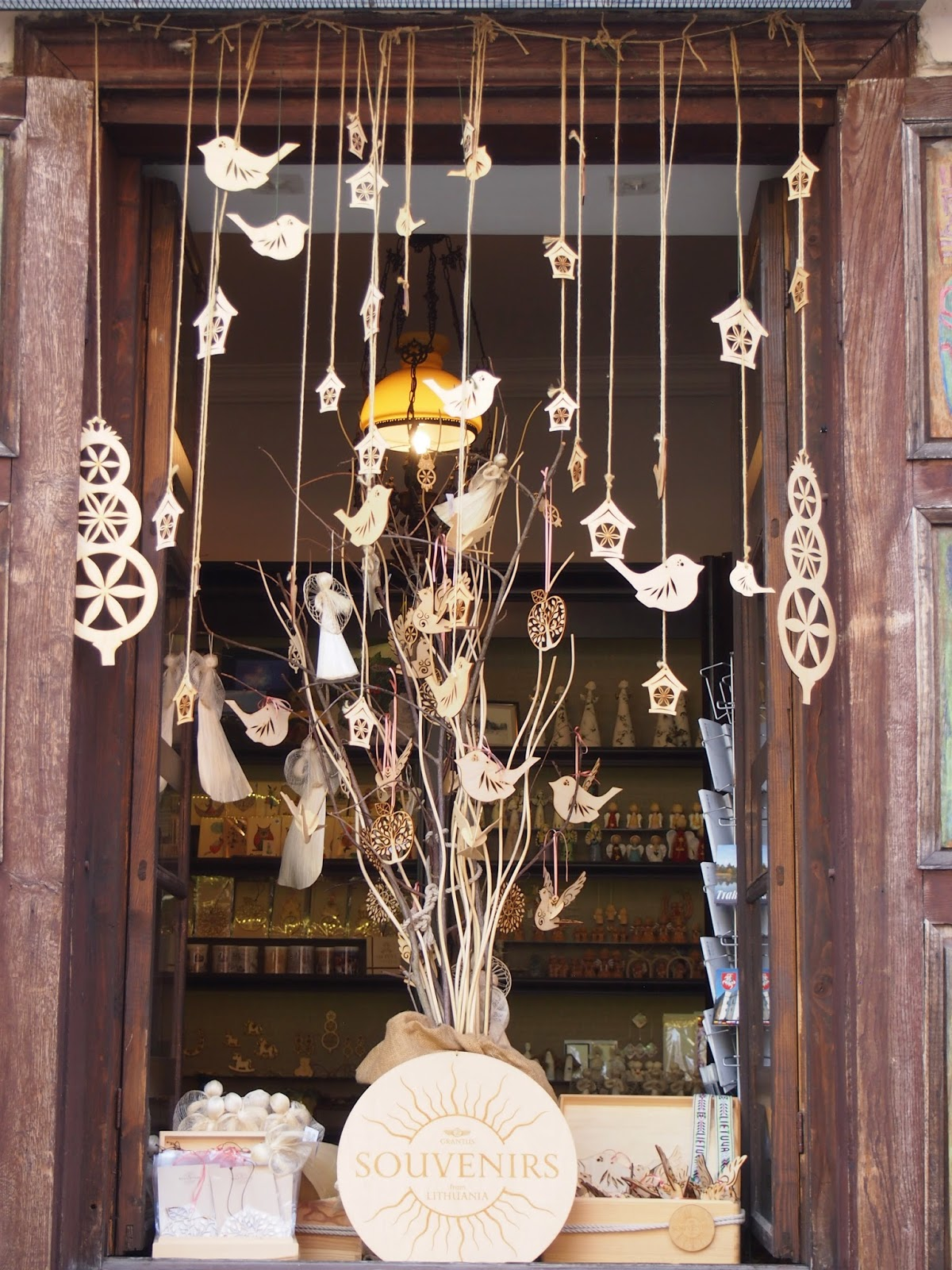 A shop window selling wooden ornaments in the Kaunas Old Town