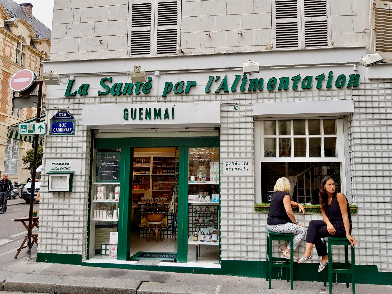 exterior of guenmaï restaurant, with customers seated at window