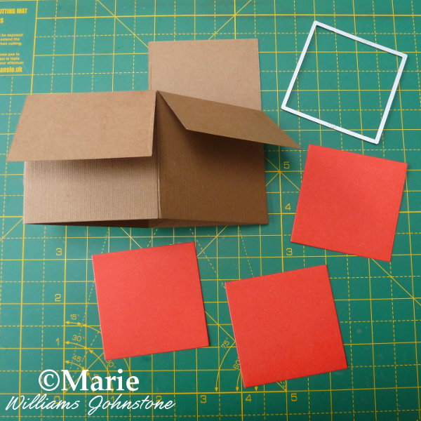 Brown pop up box card and square die cut red card pieces to decorate the bottom