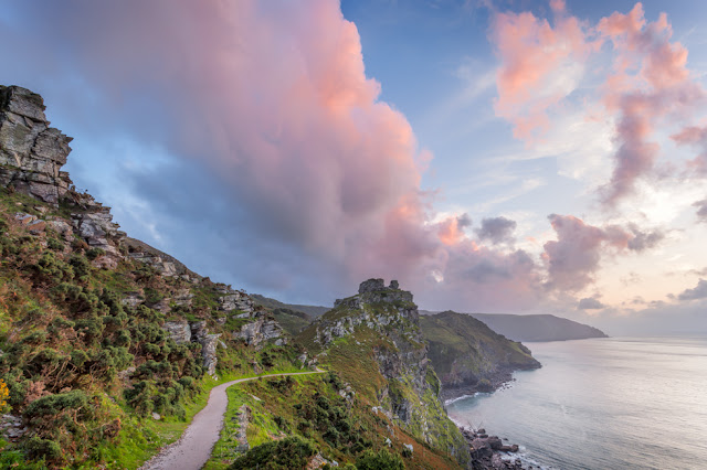 Coast path at Valley of Rocks under colourful sunset clouds in Exmoor