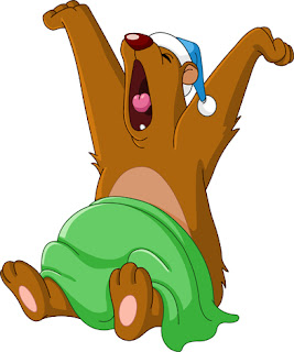 Clipart Image of a Bear in Pyjamas Waking and Yawning