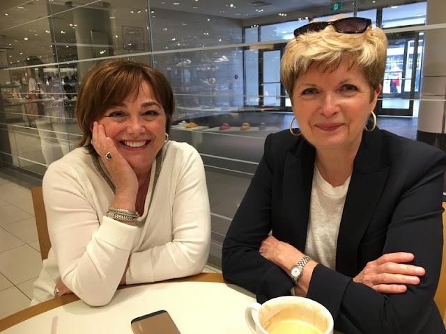 two women in a coffee bar.