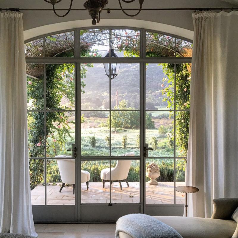 Beautiful modern farmhouse master bedroom porch at Patina Farm...decor inspiration on Hello Lovely Studio