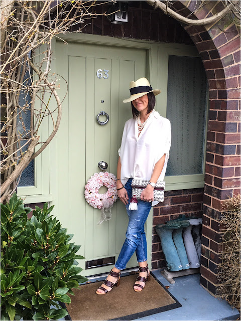 My Midlife Fashion, East oversized silk blouse, embroidered tassel clutch, h and m panama hat, zara distressed cigarette jeans, topshop venus stud sandals
