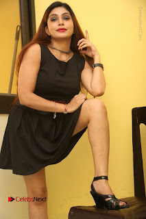 Tollywood Upcoming Actress Pooja Roshan Stills in Black Short Dress at Plus 1 Movie Trailer Launch  0167.JPG